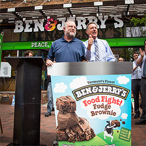 Ben & Jerry's co-founder stands behind a large pint of Food Fight Fudge Brownie, Burlington, VT, 2014